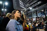 Protesters hold up signs at Martin Place during a 'Black Lives Matter' rally on 02 June, 2020 in Sydney, Australia. This event was organised to rally against aboriginal deaths in custody in Australia as well as in unity with protests across the United States following the killing of an unarmed black man George Floyd at the hands of a police officer in Minneapolis, Minnesota. (Photo by Steven Markham/ Speed Media)