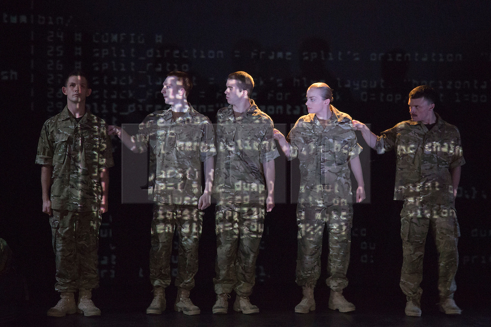 "© Licensed to London News Pictures. 07/05/2015. London, England. The Drill - Nightclub Scene. The Rosie Kay Dance Company perform ""5 Soldiers: The Body is the Frontline"" at The Rifles Officers' Club in Mayfair, London from 7 to 9 May 2015 before continuing a UK tour. 5 Soldiers gives an intimate view of the training that provides soldiers for combat and warfare and how the experience affects those that put their life on the line. Dancers: Duncan Anderson, Shelley Eva Haden, Chester Hayes, Sean Marcs and Oliver Russell. Choreographed and directed by Rosie Kay.  Photo credit: Bettina Strenske/LNP"