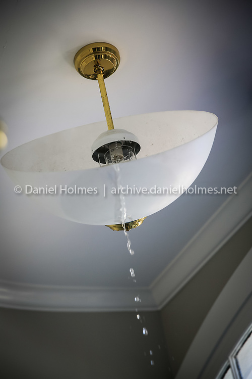 (1/4/14, HOLLISTON, MA) Water pours from a light fixture after a pipe burst at Town Hall in Holliston on Saturday. Daily News and Wicked Local Photo/Dan Holmes