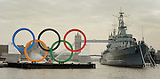 © Licensed to London News Pictures. 28/02/2012, London, UK. Giant Olympic rings measuring 11 metres high by 25 metres wide are floated down the River Thames on a barge, marking 150 days to go to the start of the London 2012 Olympic and Paralympic Games. Photo credit : Stephen Simpson/LNP