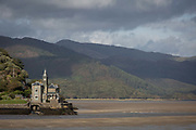 Seen from the Barmouth Bridge is Coes-Faen Spa Lodge, a former Victorian residence on the Mawddach estuary, on 13th September 2018, in Barmouth, Gwynedd, Wales. Coes Faen Lodge dates back to around 1865 and was built by the Lowe brothers, mill owners from the West Midlands, in the late 1800s, when the railway first came to the area and started the transformation of Barmouth Abermaw from a shipbuilding, fishing and trading rural community to a Victorian seaside resort destination.
