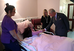 Prince Charles (known as The Duke of Rothesay when in Scotland) chats with patient Georgina Smart during his visit to the Ayrshire Hospice in Ayr where he met patients and their families, staff and volunteers, with standing-volunteer occupational therapist George Bell (left) and patient Jim Fitzsimmons (centre right) and occupational therapist Joan Carrigan (right).