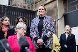 © Licensed to London News Pictures. 04/11/2019. London, UK. Antoinette Sandbach MP (who has recently defected from the Conservatives to the Liberal Democrats) stands in support before Leader of the Liberal Democrats Jo Swinson speaks to media about not being included in the televised leaders debate. A general election will be held on 12 December 2019. Photo credit : Tom Nicholson/LNP