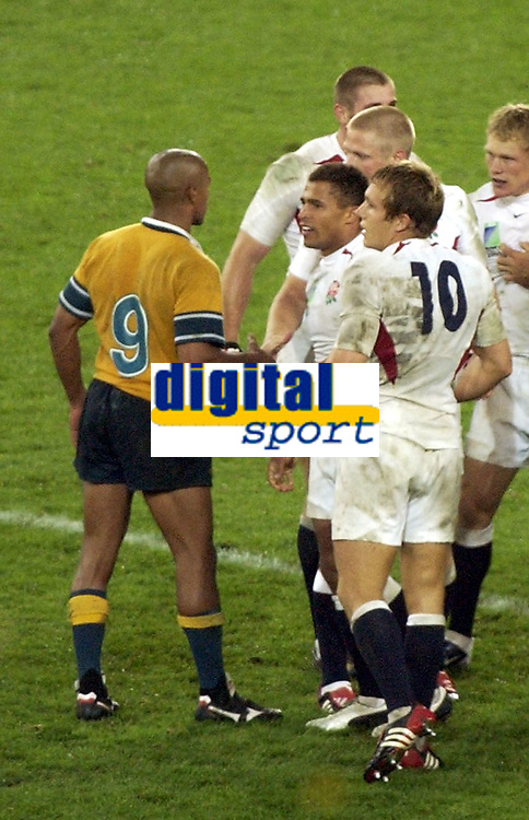 Photo. Steve Holland. England v Australia Final at the Telstra Stadium, Sydney. RWC 2003.<br />22/11/2003.<br />England after winning the World Cup with George Gregan
