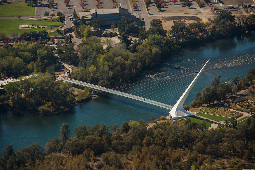 Description/Caption:<br /> Architect Santiago Calatrava designed the Sundial Bridge in Redding. the $23 million footbridge It crosses the Sacramento River and never touches the water. The Sacramento River, California's largest river flowing 375 miles, from Mount Shasta in the north through the Central Valley and the Delta to San Francisco Bay, this river constitutes an irreplaceable resource to Northern California's ecology...Boating, fishing, camping and swimming on the Sacramento and its reservoirs attract more than 8 million visitors a year. ..The 21-mile stretch from Redding to Balls Ferry is perfect for scenic touring and shorter trips. For the adventuresome, the breath-taking 33-mile stretch between Balls Ferry and Red Bluff is your ticket...The Sundial Bridge is actually a working Sundial is 700 feet long, 23 feet wide and 217 feet high (pylon). The bridge weighs 3.2 million pounds (1,600 tons) and is composed of steel with galvanized steel cables. The deck materials are non-skid glass panels in steel framework with granite accents. The foundation consists of 115 tons of rebar, 1,900 cubic yards of concrete and a superstructure of 400 tons of steel. 200 tons of glass and granite were utilized in deck construction. The bridge contains 4,342 feet of cable and the pylon is 580 tons of steel.