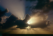Burst of God rays from clouds over water near Antigua in the West Indies.