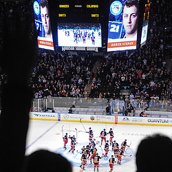 New York Rangers players salute the crowd following NHL action between the Columbus Blue Jackets and the New York Rangers at Madison Square Garden in New York, N.Y. The Rangers defeated the Blue Jackets 3-2 in overtime.