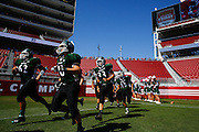 Manteca players take the field against Oakdale during Friday Night Lights at Levi's Stadium in Santa Clara, California, on October 11, 2014. (Stan Olszewski/ Special to The Record)