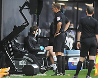 Football - 2020 / 2021 Premier League - Fulham vs Crystal Palace - Craven Cottage<br /> <br /> Referee, Graham Scott reviews Aboubakar Kamara's dangerous tackle, which resulted in him being sent off<br /> <br /> <br /> COLORSPORT/ANDREW COWIE