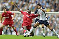 Fotball<br /> England 2005/2006<br /> Foto: Colorsport/Digitalsport<br /> NORWAY ONLY<br /> <br /> Jermaine Jenas (Tottenham) making his debut,challenges Momo Sissoko (Liv)<br /> <br /> Tottenham Hotspur v Liverpool<br /> 10/9/2005