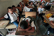 Children at the Escuela Cardinal Oscar Andres Rodrigues wait to be dismissed at the end of the school day.  Even though Honduras has 94% school enrolment, only 40% complete their schooling.  Honduras is considered the third poorest country in the Western Hemisphere (Haiti, Nicaragua). With over 50% of the population living below the poverty line and 28% unemployed, Hondurans frequently turn to illegal immigration as a solution to their desperate situation. The Department of Homeland Security has noted an 95% increase in illegal immigrants coming from Honduras between 2000 and 2009, the largest increase of any country.