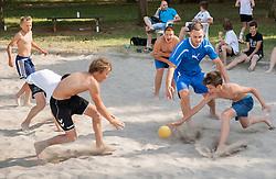 """Luka Zvizej and kids during Handball Summer Camp named """"Zormanov rokometni tabor"""" on June 29, 2013 in Savudrija, Croatia. (Photo by Vid Ponikvar / Sportida.com)"""