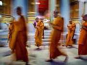 """13 MAY 2013 - BANGKOK, THAILAND: Buddhist monks walk clockwise around Wat That Thong during services on Vesak in the temple. Vesak, called Wisakha Bucha in Thailand, is one of the most important Buddhist holy days celebrated in Thailand. Sometimes called """"Buddha's Birthday"""", it actually marks the birth, enlightenment (nirvana), and death (Parinirvana) of Gautama Buddha in the Theravada or southern tradition. It is also celebrated in Cambodia, Laos, Myanmar, Sri Lanka and other countries where Theravada Buddhism is the dominant form of Buddhism.     PHOTO BY JACK KURTZ"""
