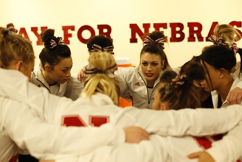 Madison McConkey and her teammates huddle before taking on Minnesota at the Bob Devaney Sports Center in Lincoln, Neb., on Feb. 12, 2016. Photo by Aaron Babcock, Hail Varsity