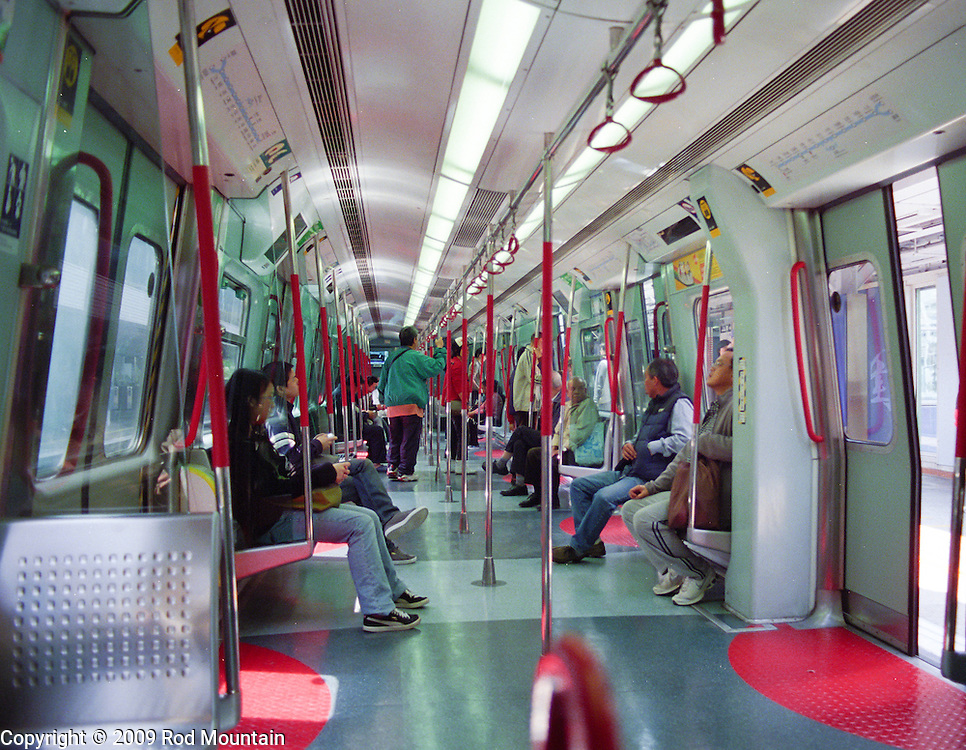An MTR transit car in Hong Kong with plent of seats available between the morning and afternoon rushes.