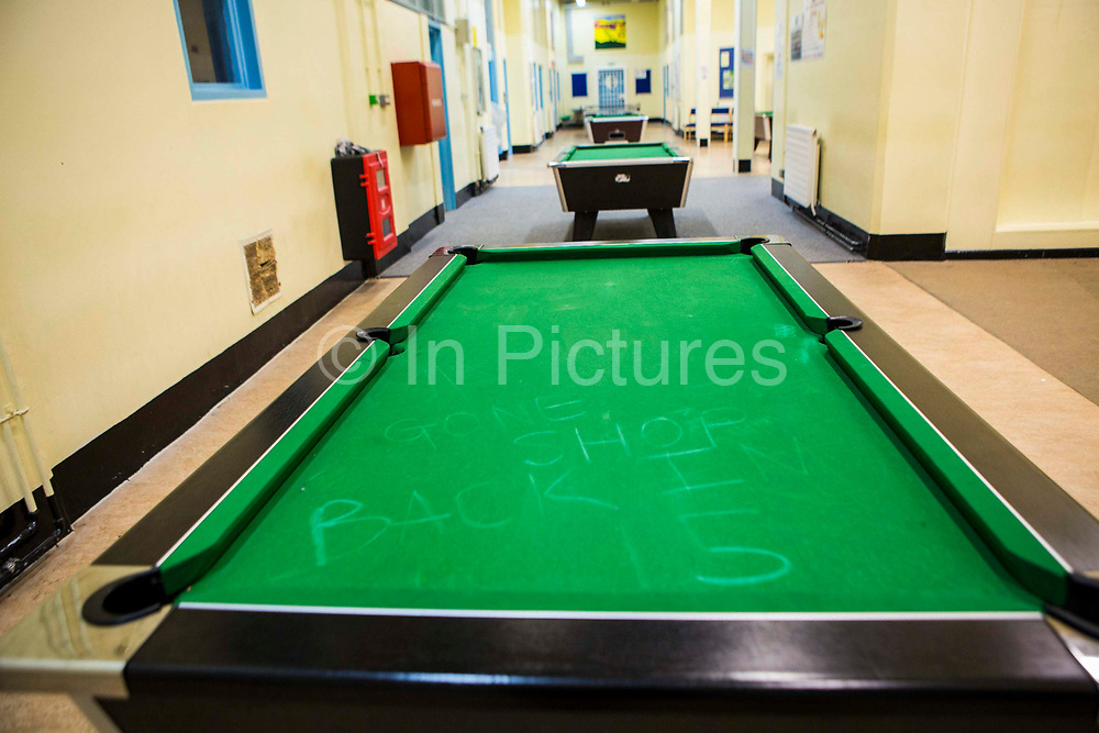 """Graffiti written on the pool table"""" """"Gone Shop, back in 15"""" Raleigh wing, HMP/YOI Portland, a resettlement prison with a capacity for 530 prisoners."""