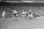 Dublin player runs chased by Galway players during the All Ireland Senior Gaelic Football Championship Final Dublin V Galway at Croke Park on the 22nd September 1974. Dublin 0-14 Galway 1-06.