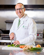 Environmental portrait of Dr. Glenn Mack with the Northwest Arkansas Community College's culinary and hospitality program stands in the school's kitchen on Tuesday, December 15, 2015, in Bentonville, Ark. Photo by Beth Hall