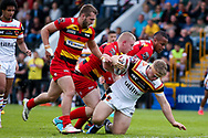 Bradford Bulls hooker Sam Hallas (29) is tackled during the Kingstone Press Championship match between Dewsbury Rams and Bradford Bulls at the Tetley's Stadium, Dewsbury, United Kingdom on 4 June 2017. Photo by Simon Davies.
