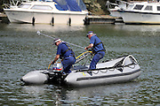 © licensed to London News Pictures. RICHMOND, UK.  01/08/11. The Metropolitan police search the River Thames near Richmond, London, today (1 Aug 2011) after a 17 year boy went missing after taking part in a kayak competition.  Mandatory Credit Stephen Simpson/LNP