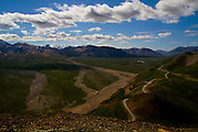 View of the main plateau, from Polychrome, Denali National Park, showing the shuttle bus road at Polychrome Pass. You can see The Mountain, Denali aka Mount McKinley on the horizon, right of the photograph's centre...