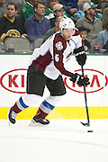 DALLAS, TX - NOVEMBER 1:  Erik Johnson #6 of the Colorado Avalanche controls the puck against the Dallas Stars on November 1, 2013 at the American Airlines Center in Dallas, Texas.  (Photo by Cooper Neill/Getty Images) *** Local Caption *** Erik Johnson