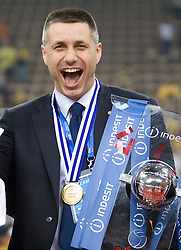 Coach  of Trentino Radostin Stoytchev celebrates with a Trophy at final ceremony after the  final match of CEV Indesit Champions League FINAL FOUR tournament between Dinamo Moscow, RUS and Trentino BetClic, ITA on May 2, 2010, at Arena Atlas, Lodz, Poland. Trentino defeated Dinamo 3-0 and became Winner of the Champions League. (Photo by Vid Ponikvar / Sportida)