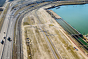 Nederland, Zuid-Holland, Rotterdam, 18-02-2015; Euopaweg buigt af naar de Maasvlakte. Infrabundel van autosnelweg N15, spoorweg (Betuweroute) en hoogspanningsleidingen. <br /> New and man-made land in the North sea <br /> designated for the Port of Rotterdam. Infrastructure bundle: motorway, railway (Betuweroute) and power lines.<br /> luchtfoto (toeslag op standard tarieven);<br /> aerial photo (additional fee required);<br /> copyright foto/photo Siebe Swart
