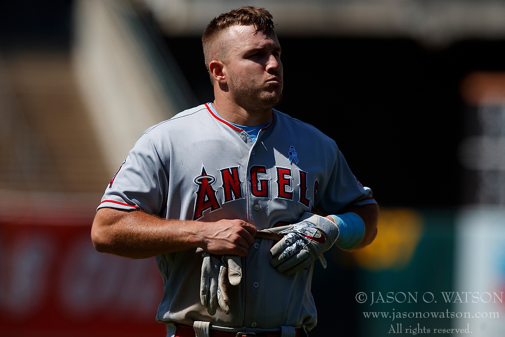 OAKLAND, CA - JUNE 17: Mike Trout #27 of the Los Angeles Angels of Anaheim stand on the field during the ninth inning against the Oakland Athletics at the Oakland Coliseum on June 17, 2018 in Oakland, California. The Oakland Athletics defeated the Los Angeles Angels of Anaheim 6-5 in 11 innings. (Photo by Jason O. Watson/Getty Images) *** Local Caption *** Mike Trout