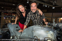 """Custom bike builder Keiji Kawakita of Hot Dock in Tokyo with his daughter Hiromi """"Gypsy"""" Kawakita and his BMW custom commission at EICMA, at EICMA, the largest international motorcycle exhibition in the world. Milan, Italy. November 17, 2015.  Photography ©2015 Michael Lichter."""