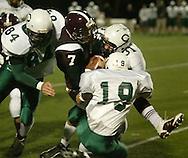 Cornwall's Brian McNally (84), Matt Moretto (31) and Mike O'Rourke (19) tackle Harrison quarterback Matt Ciraco during a Class A state quarterfinal game at Mahopac High School on Nov. 10, 2006.
