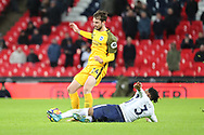 Danny Rose of Tottenham Hotspur (3) performing a sliding tackle on Brighton and Hove Albion midfielder Davy Propper (24) during the Premier League match between Tottenham Hotspur and Brighton and Hove Albion at Wembley Stadium, London, England on 13 December 2017. Photo by Matthew Redman.