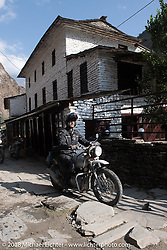 Corey Froschheuser on the main street of Tatopani starting out on Day-7 of our Himalayan Heroes adventure riding from Tatopani to Pokhara, Nepal. Monday, November 12, 2018. Photography ©2018 Michael Lichter.