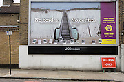 Landscape of the anti-EU 'UK Independence Party's (UKIP) political billboard shows an escalator leading up the white cliffs of Dover (a metaphor for unrestricted immigration access to Britain) in East Dulwich - a relatively affluent district of south London. The ad is displayed before European elections on 22nd May and UKIP's controversial right-wing policy of no foreigners into the UK to take British jobs, is promising to do well in the forthcoming election.