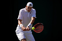 John Isner in action against Yannick Maden on day one of the Wimbledon Championships at the All England Lawn Tennis and Croquet Club, Wimbledon.