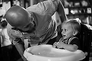 My son Adam Pratt and laughs with his son Jamison at his first birthday party.