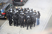 Exclusive Police get ready to strom flat in Paris