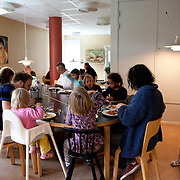 Stockholm, Sweden, August 28, 2012. Södra station, collective with 63 flats for all ages. The dining room is the heart of the community. The adults in the house are part of a cooking team with shifts every four weeks. The common dinner is from Monday to Thursday during school term. In 2012 Södra station celebrates the 25th Anniversary.