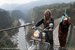 Beanre (Kevin Doebler) on the Kusma Gyadi Bridge, the tallest (443') and one of the longest (1,128') suspension bridges in the country, on Day-7 of our Himalayan Heroes adventure riding from Tatopani to Pokhara, Nepal. Monday, November 12, 2018. Photography ©2018 Michael Lichter.
