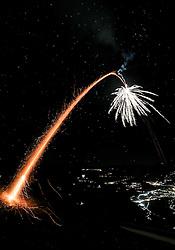 THEMENBILD - eine Silvesterrakete startet in den Nachthimmel, aufgenommen am 31.12.2016 in Aschau // a rocket starts into the clear night sky on New Year´s Eve, Aschau, Austria on 2016/12/31. EXPA Pictures © 2016, PhotoCredit: EXPA/ Jakob Gruber