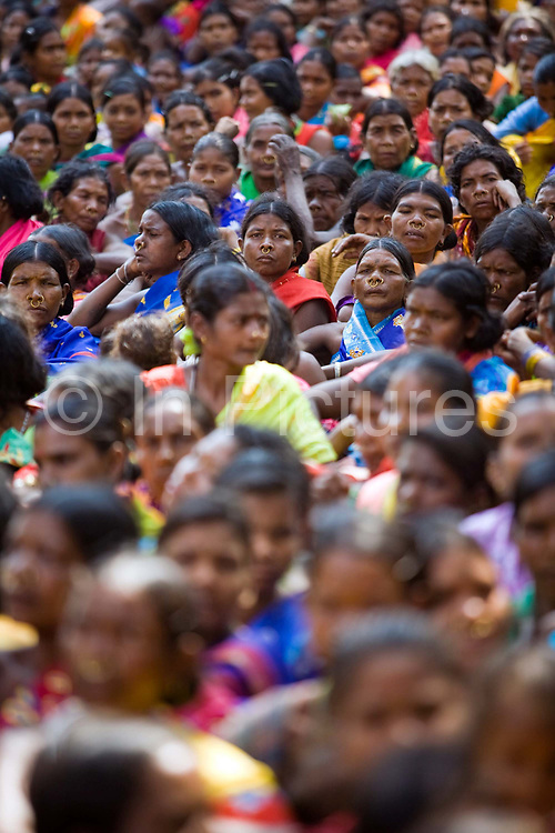 Tribal women gather to protest and listen to speeches at Bijepur at a rally organised by the Adim Adhikar Surakshya Manch (a group to protect tribal groups) against the Vedanta plant. The Dongria Kondh are a protected 'Scheduled' Caste of Original (aboriginal) people that practice animism and live a settled rural life. Their deity is a mountain from which a mining company, Vedanta is seeking to extract bauxite which will largely destroy the mountain and the Kondh's traditional way of life.