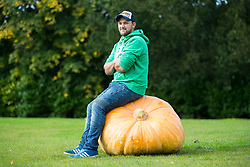 © Licensed to London News Pictures. 15/09/2017. Harrogate UK. Richard Mann with his prize winning Pumpkin at the Giant Vegetable competition at this years Harrogate Autumn Flower Show in Yorkshire. Photo Credit: Andrew McCaren/LNP