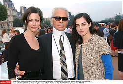 Model Anna Mouglalis (L) and French actress Amira Casar attend the presentation of German fashion designer Karl Lagerfeld's cruise collection 2004/05 on a boat along the Seine in Paris-France on May 26, 2004. Photo by Bruno Klein/ABACA.
