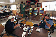 Near Area 51, Extraterrestrial Highway near Rachel, Nevada.  UFO hunters from Georgia at breakfast in 'Little A'Le'Inn'. Model Released (1999).