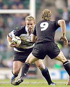 Twickenham, Surrey, 4th December 2004, The Gartmore Challenge Rugby Cup,  Barbarians vs New Zealand, RFU Stadium, England,<br /> Baabaa's scrum scrum half Justin MARSALL, looks to go around his  All Black counter part Jimmy Cowan.<br />  <br /> [Mandatory Credit; Peter Spurrier/Intersport Images]