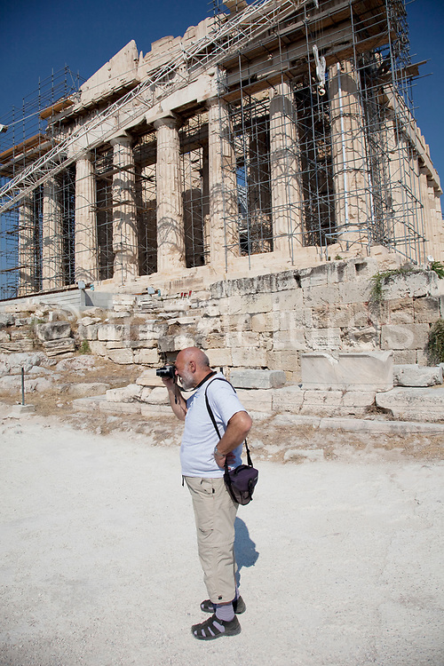 Tourists and visitors at the Parthenon at Acropolis of Athens. The Parthenon and other main buildings on the Acropolis were built by Pericles in the fifth century BC as a monument to the cultural and political achievements of the inhabitants of Athens. The term acropolis means upper city and many of the city states of ancient Greece are built around an acropolis where the inhabitants can go as a place of refuge in times of invasion. It's for this reason that the most sacred buildings are usually on the acropolis. It's the safest most secure place in town. As little as 150 years ago there were still dwellings on the Acropolis of Athens. Athens is the capital and largest city of Greece. It dominates the Attica periphery and is one of the world's oldest cities, as its recorded history spans around 3,400 years. Classical Athens was a powerful city-state. A centre for the arts, learning and philosophy.