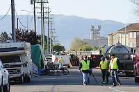 Under police guard on roped-off streets, workers hired by the city of Salinas clean out homeless encampments on Thursday, March 24th in the Market Way area of Chinatown.