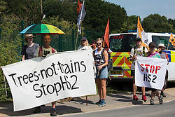 Activists from HS2 Rebellion and Extinction Rebellion UK stand opposite a gate to a HS2 construction site as they take part in a 'Rebel Trail' hike along the route of the HS2 high-speed rail link on 26th June 2020 in Harefield, United Kingdom. The activists, who departed from Birmingham on 20th June and will arrive outside Parliament in London on 27th June, are protesting against the environmental impact of the high-speed rail link and questioning the viability of the £100bn+ project.