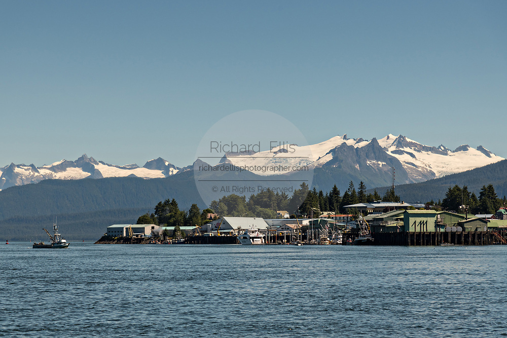 The main fishing port in the tiny village of Petersburg on Mitkof Island along the Wrangell Narrows in Frederick Sound with the Alaska Coast Range of mountains behind on Mitkof Island, Alaska. Petersburg settled by Norwegian immigrant Peter Buschmann is known as Little Norway due to the high percentage of people of Scandinavian origin.