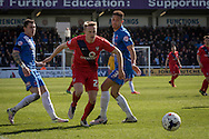 Reece Thompson of York City FC (22)in action skips past Hartlepool United defender Jake Carroll during  the Sky Bet League 2 match between Hartlepool United and York City at Victoria Park, Hartlepool, England on 16 April 2016. Photo by George Ledger.